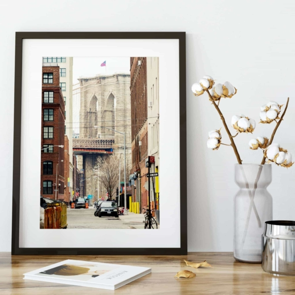 Brooklyn Bridge View From Brooklyn print in black frame on the shelf
