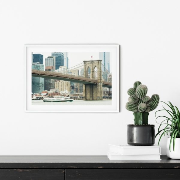 Brooklyn Bridge and East River in white frame on the wall