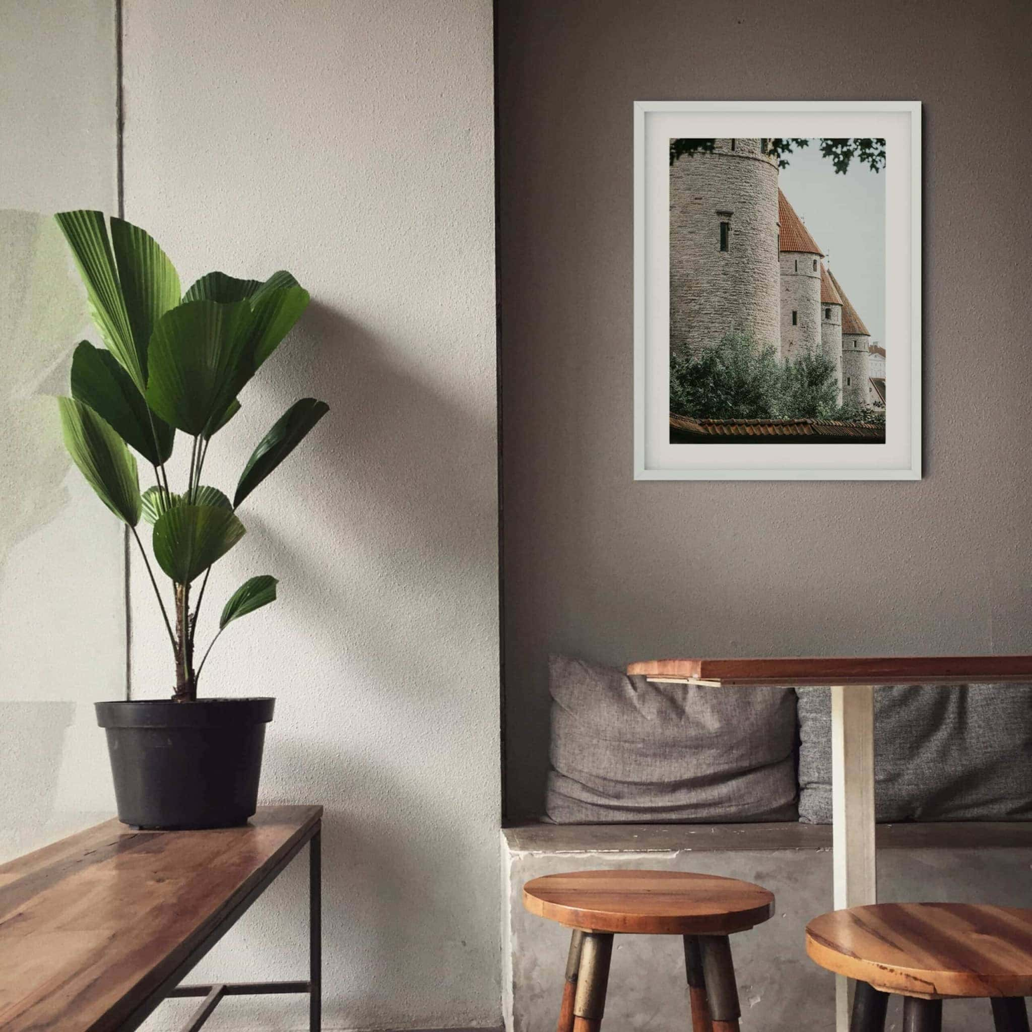 Four Towers photography print in white frame on the wall in a cafe
