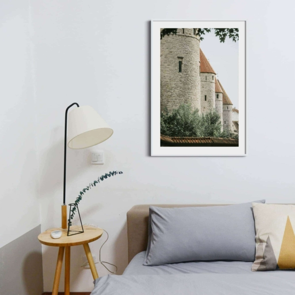 Four Towers Print in white frame on the wall in the bedroom