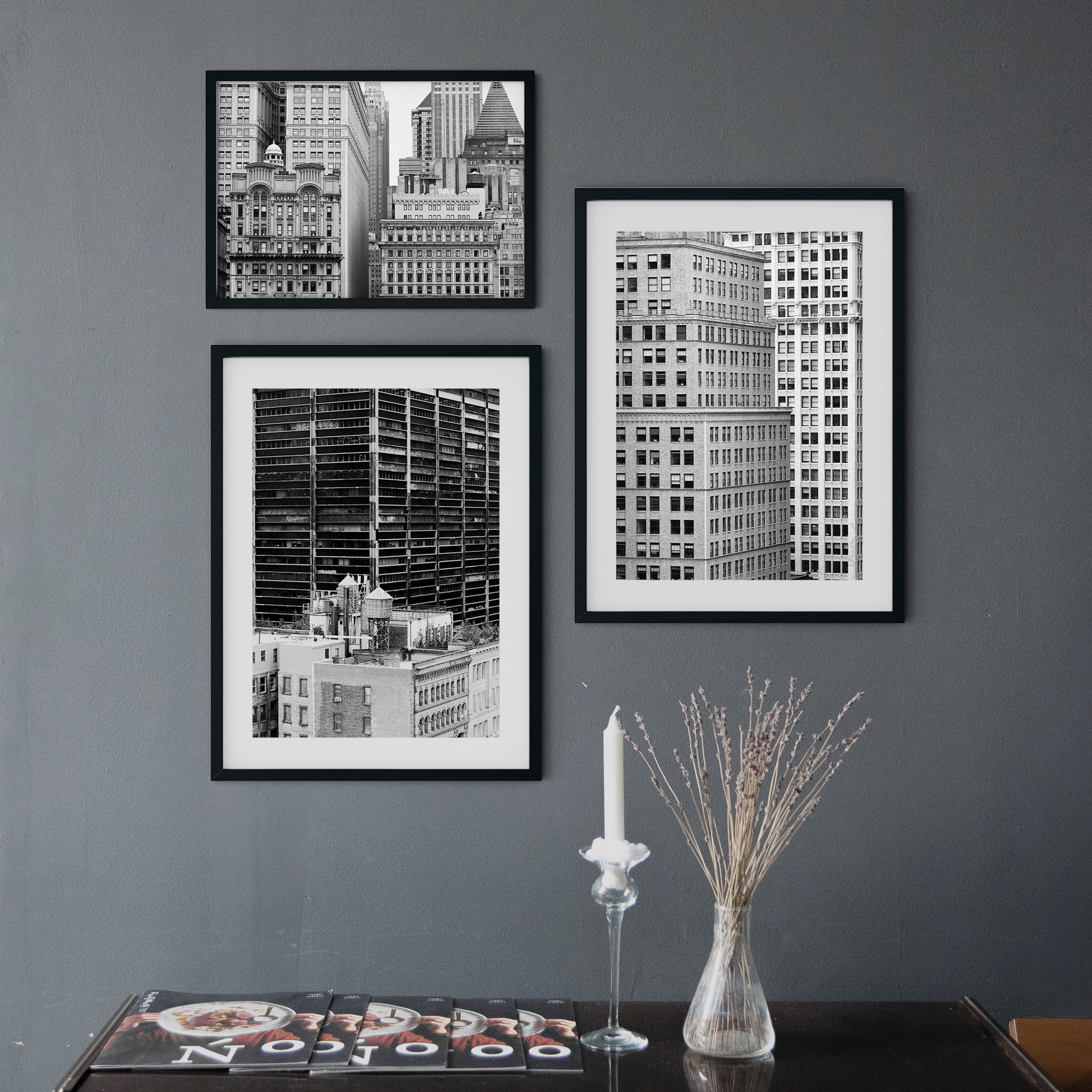 Manhattan Architecture gallery wall. Black and white prints in black frame on the wall in interior