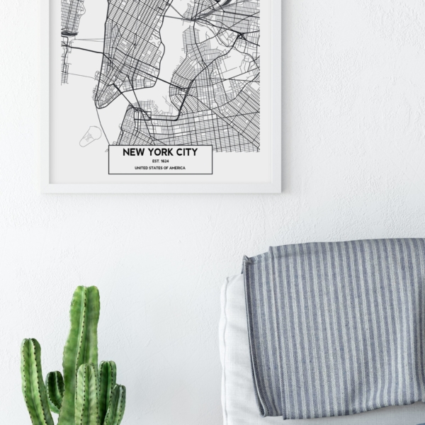New York City map in white frame on the wall