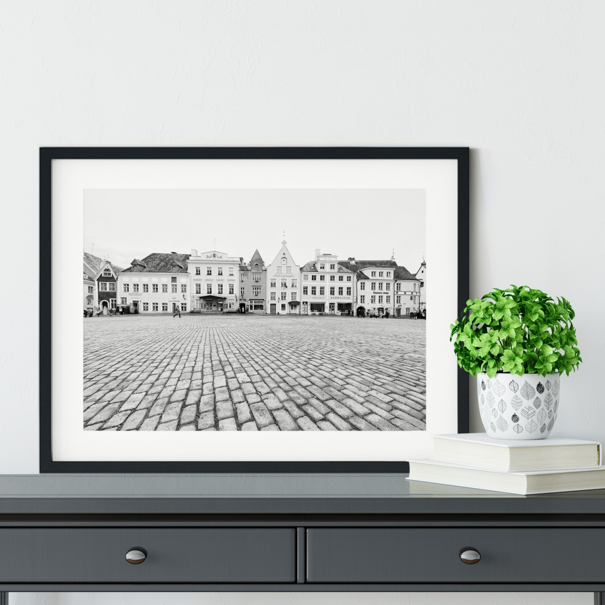 Tallinn Raekoja Platz Print in black frame on the shelf