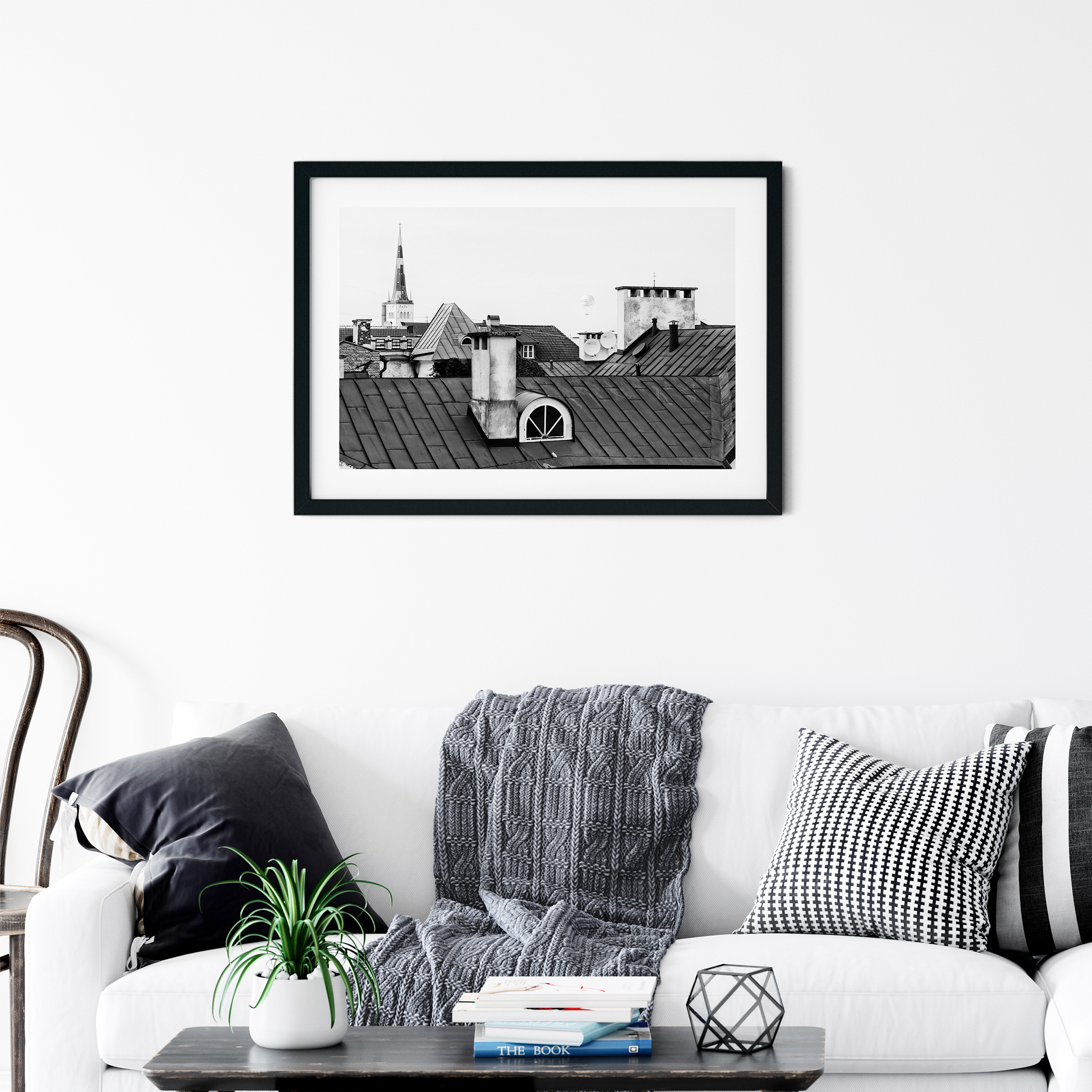 Tallinn Roofs - black and white photography print in the black frame on the wall in interior