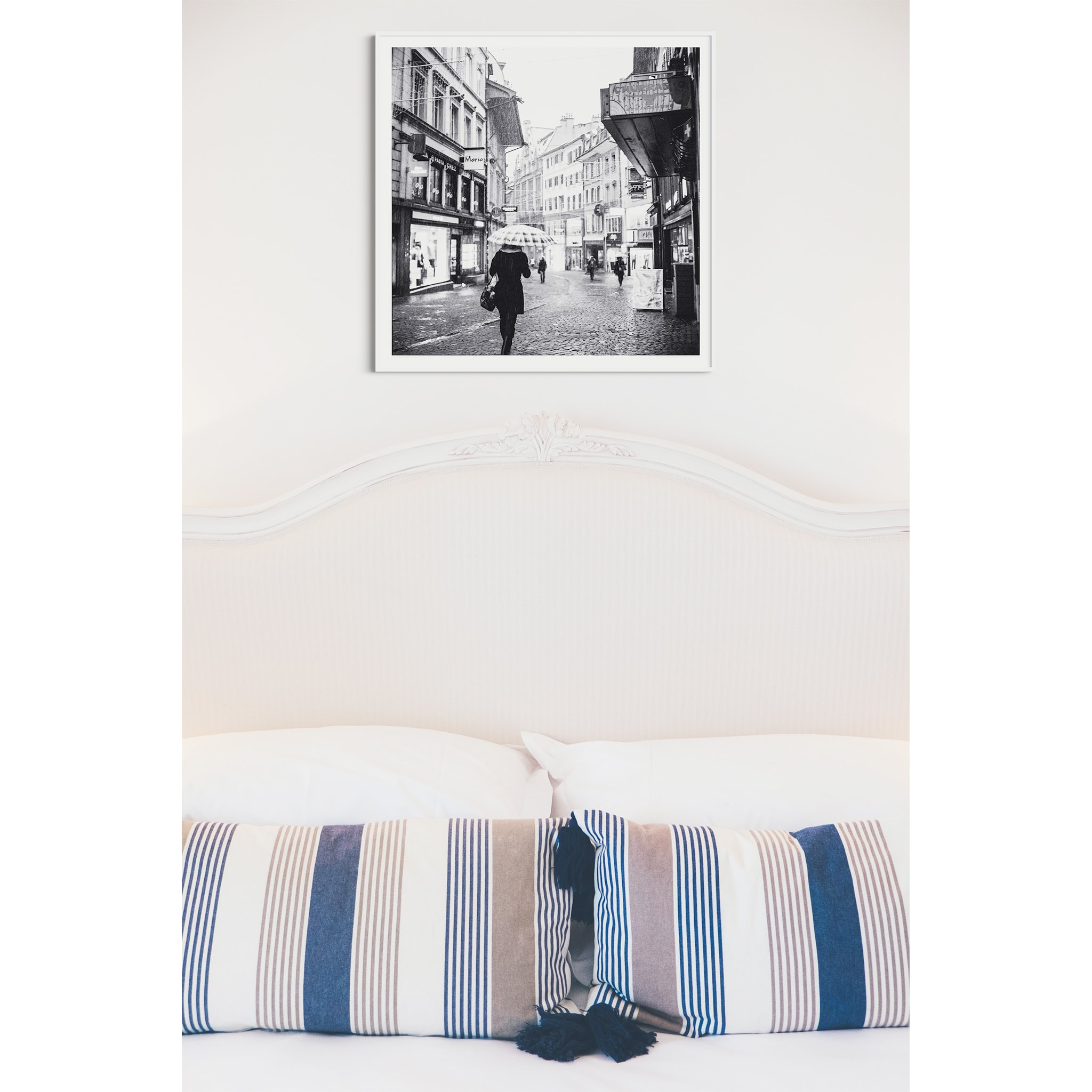 Rainy Mood In Lausanne print in white frame with border over the bed