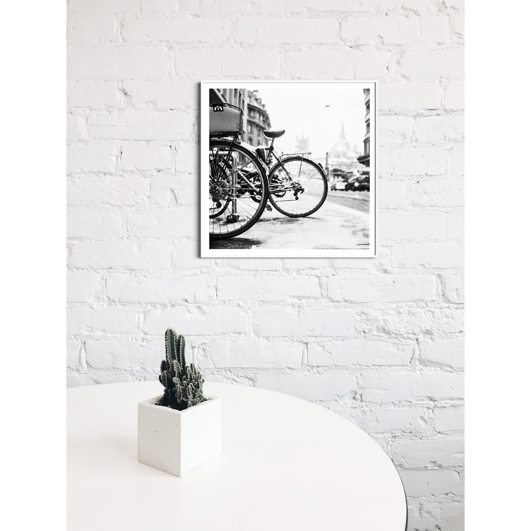 lausanne bicycles in snow print in white frame with border on the wall