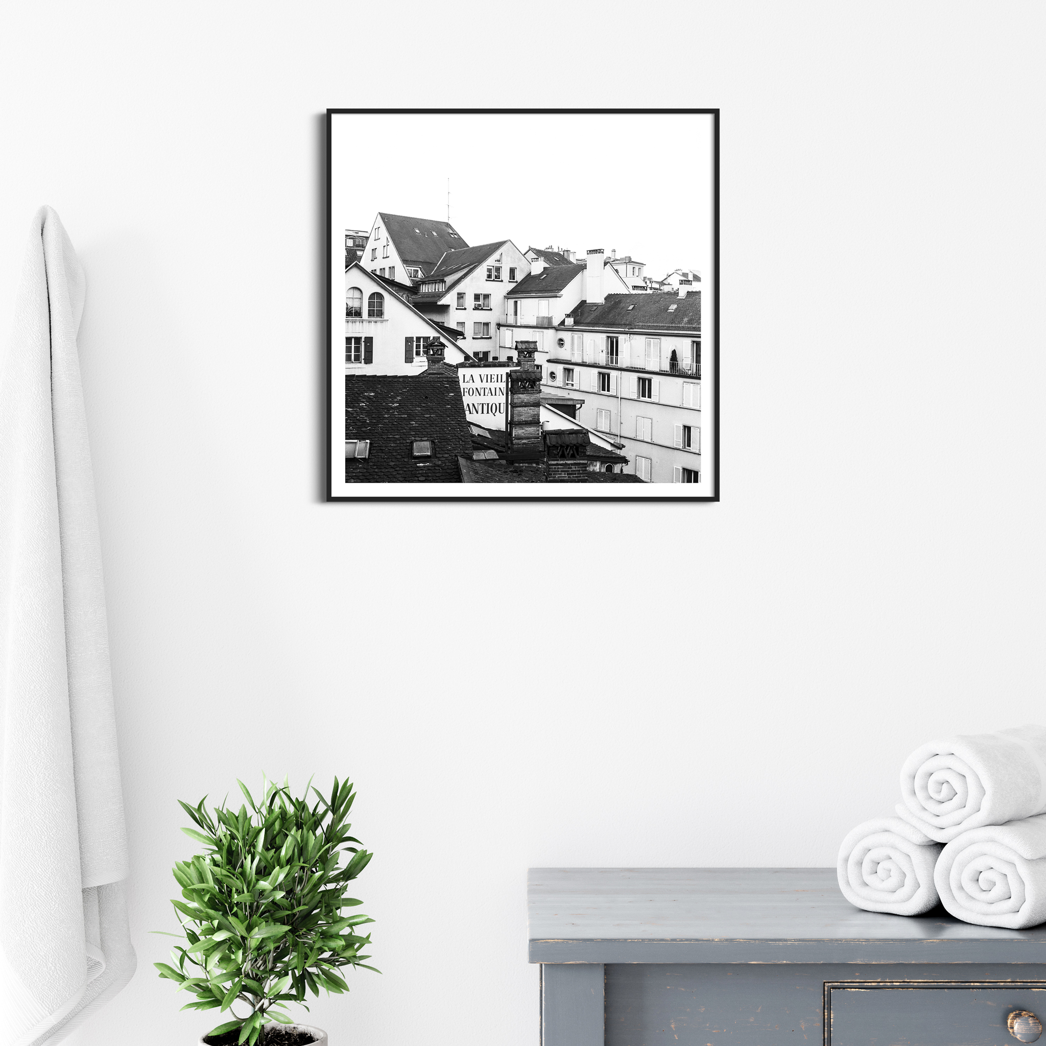 Lausanne Roofs - black and white print in black frame with border on the wall