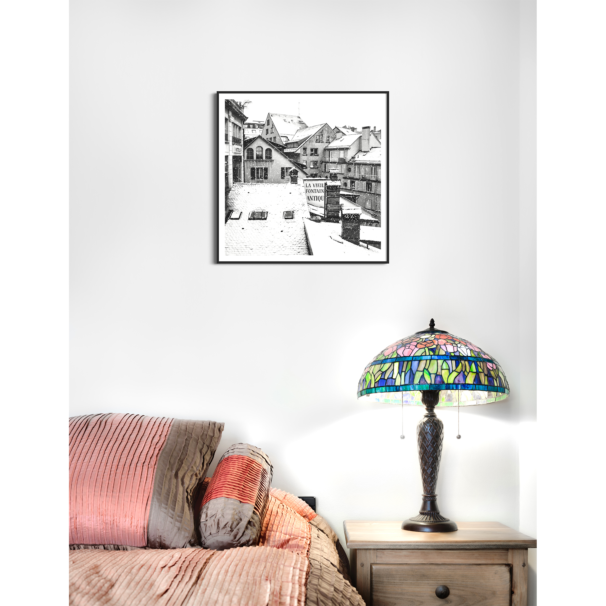 Snowy Day in Lausanne black and white print in black frame with border on the wall