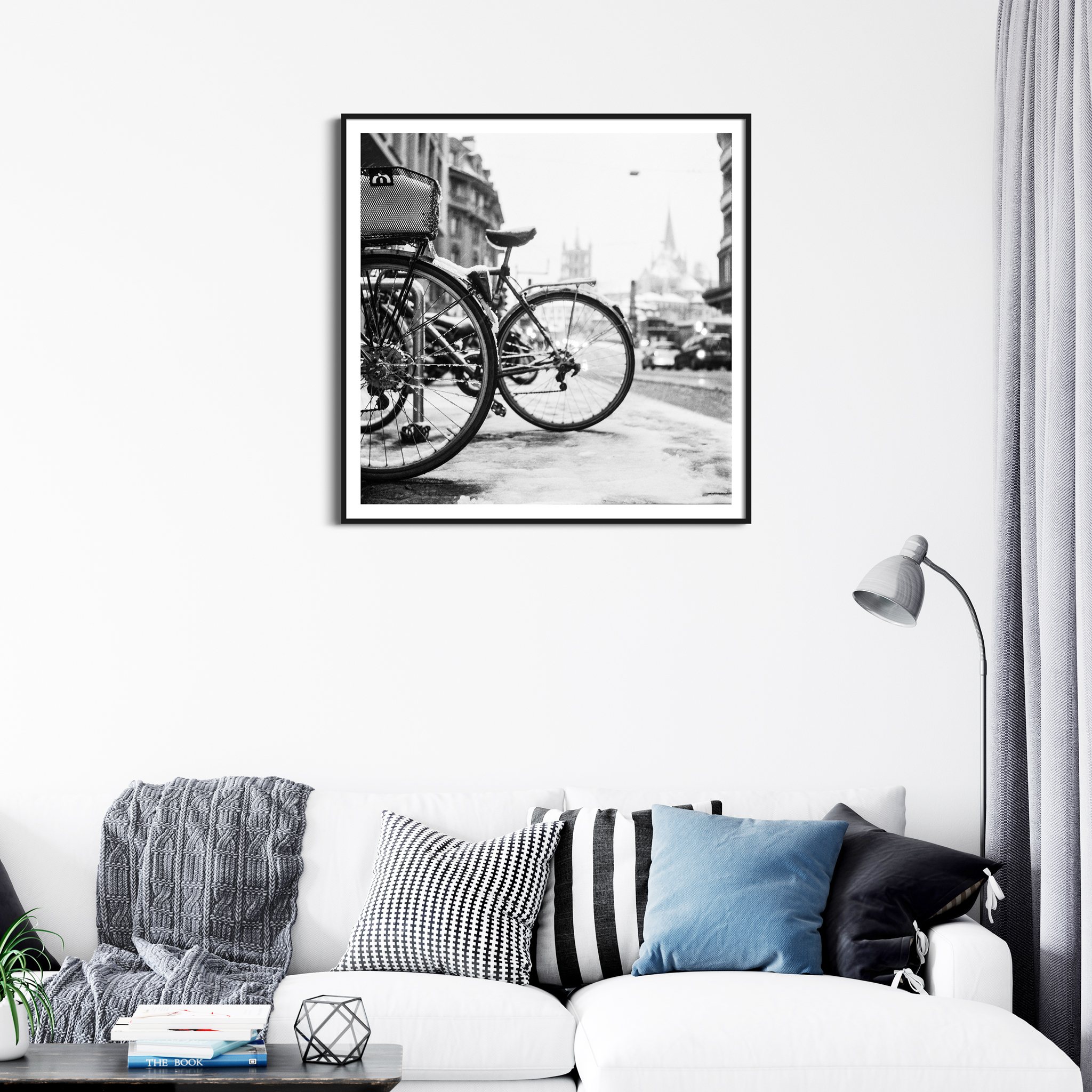 Bicycles in Lausanne in Snow - black and white print in black frame with border on the wall
