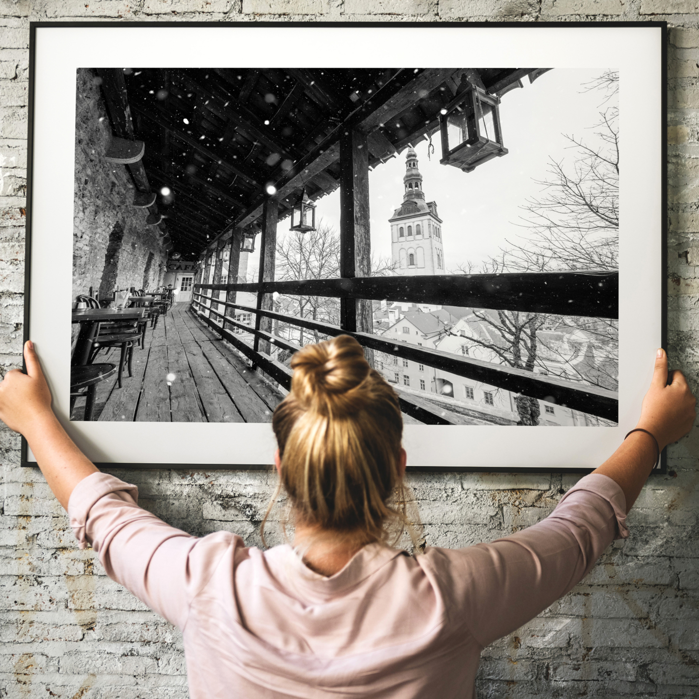 Winter in Tallinn - black and white photography print in black frame with border - hanging on the wall
