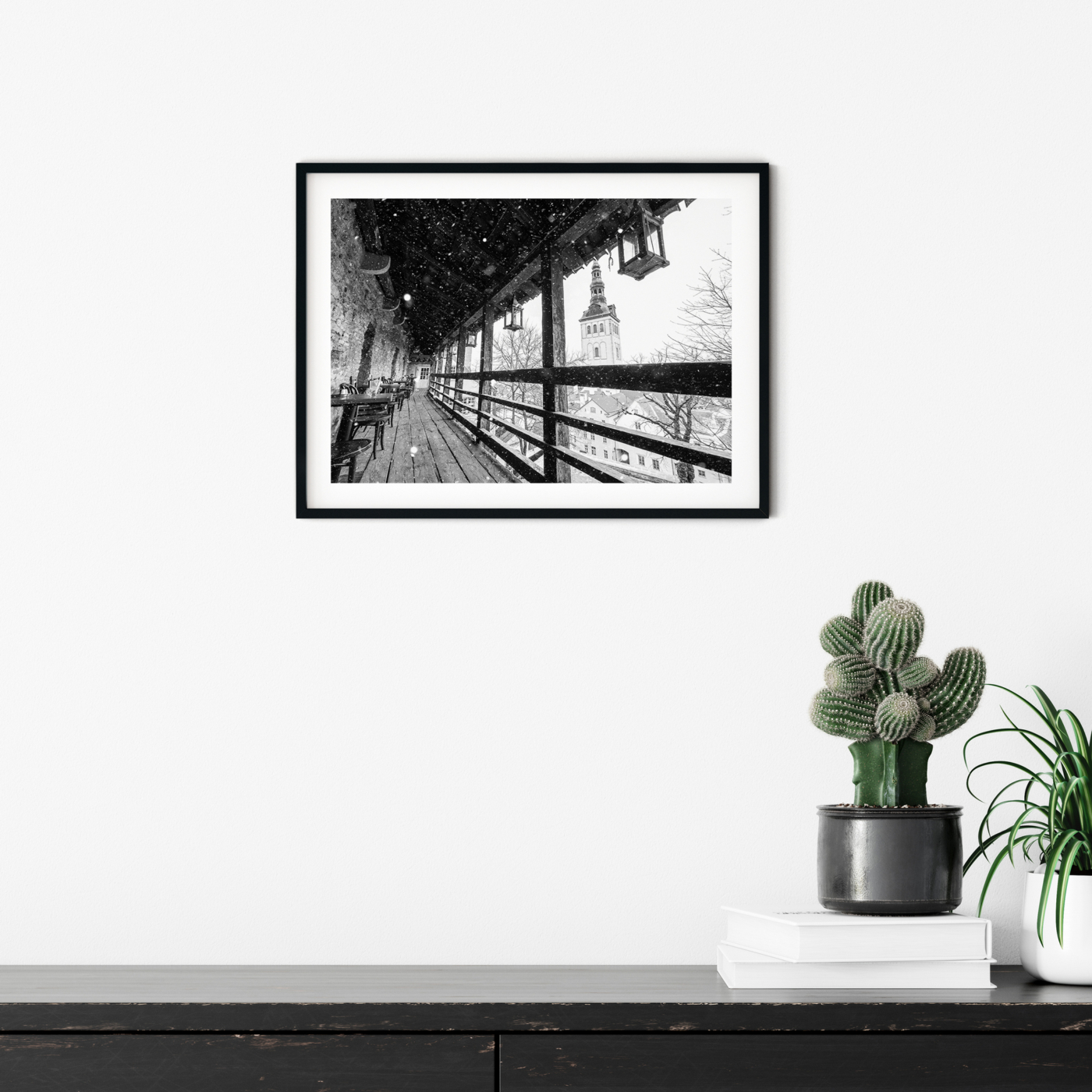 Winter in Tallinn - black and white photography print in black frame with border on the wall in interior