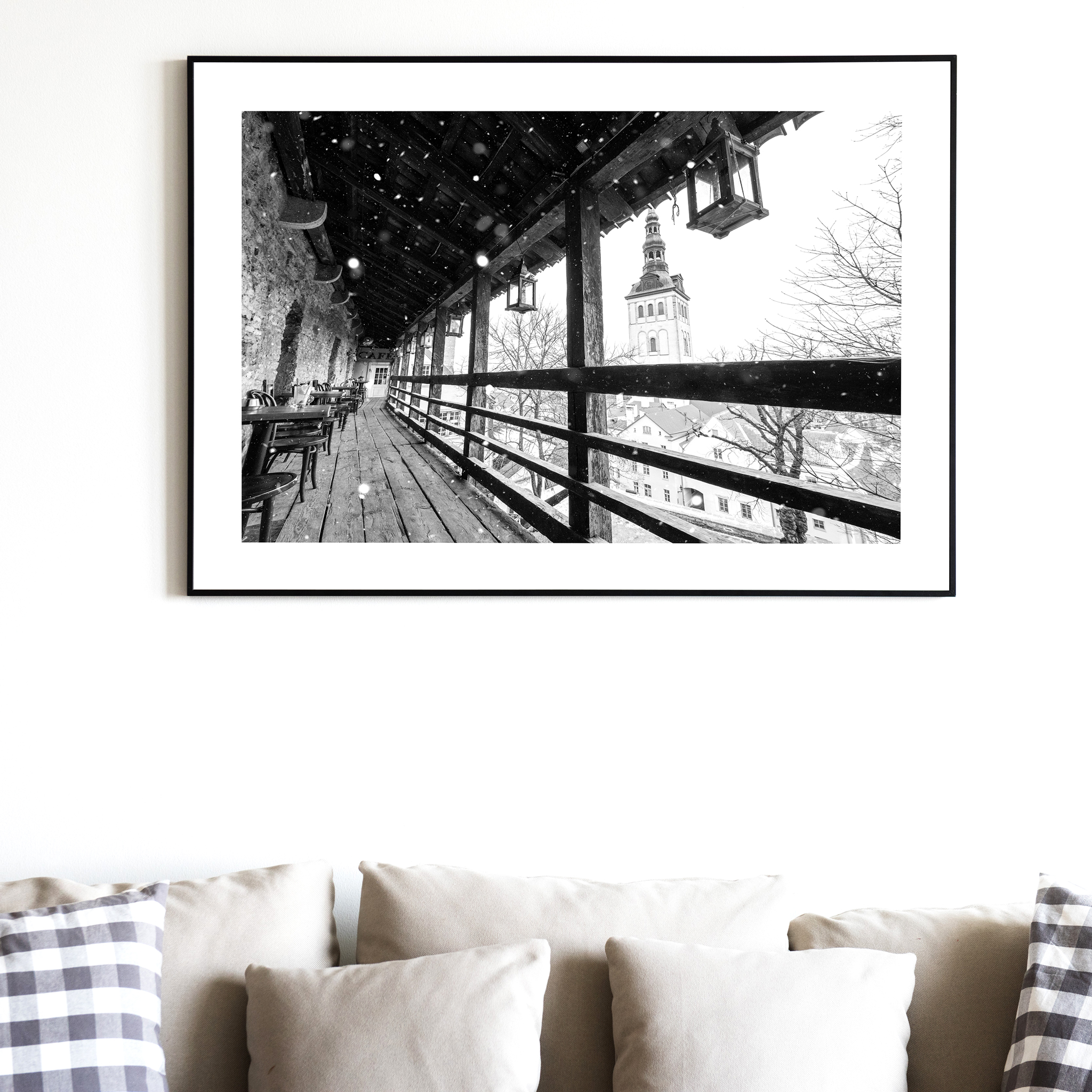 Winter in Tallinn - black and white photography print with border on the wall over the coach