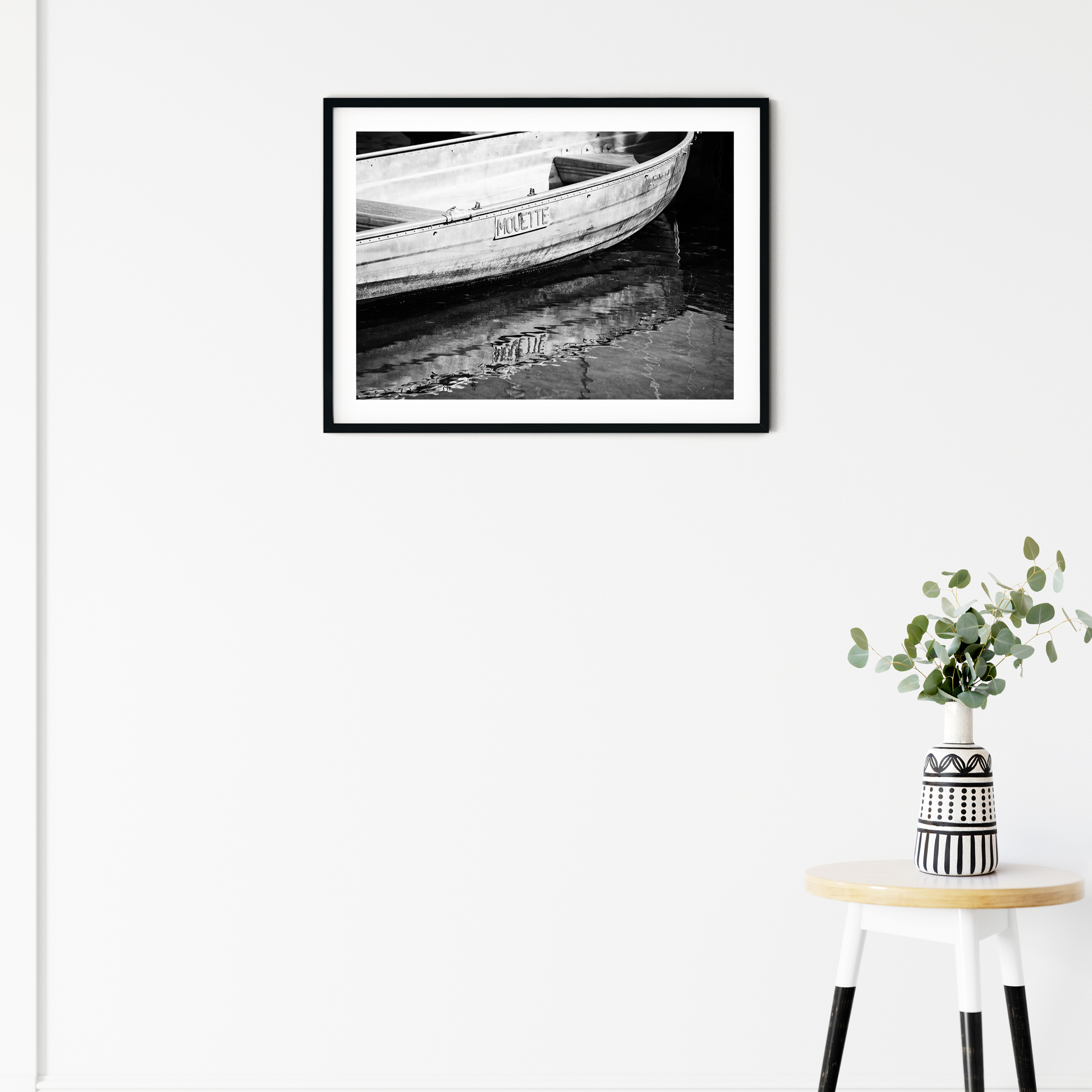 Boat in Geneva - black and white print with border in black frame on the wall