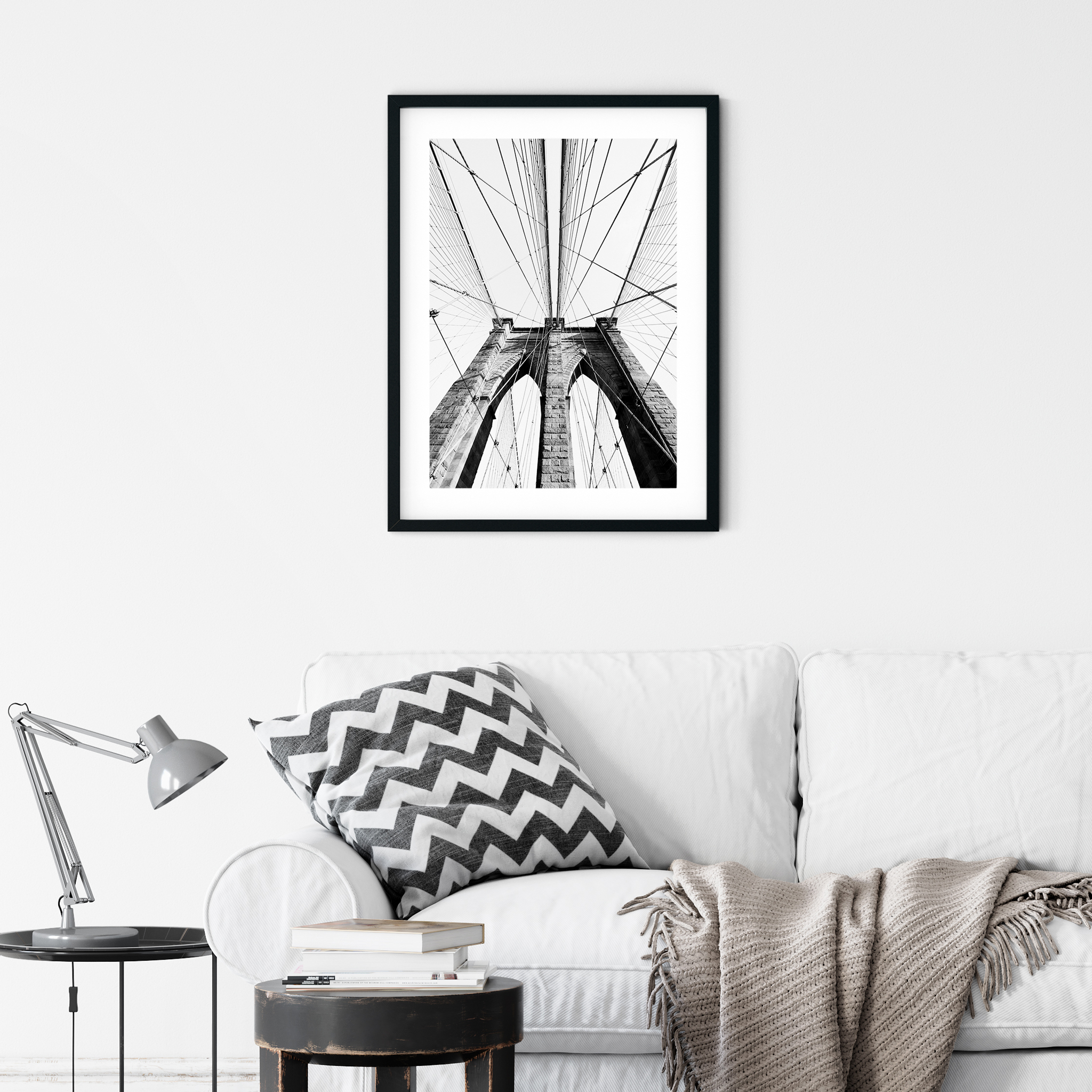 Brooklyn Bridge: Classic View - black and white print in black frame on the wall over the sofa