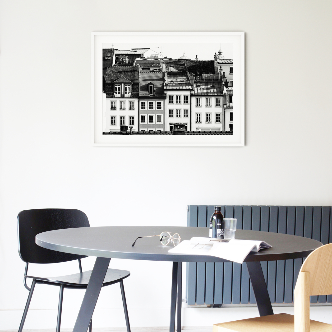 Lausanne Roofs II - black and white print with border in white frame on the wall