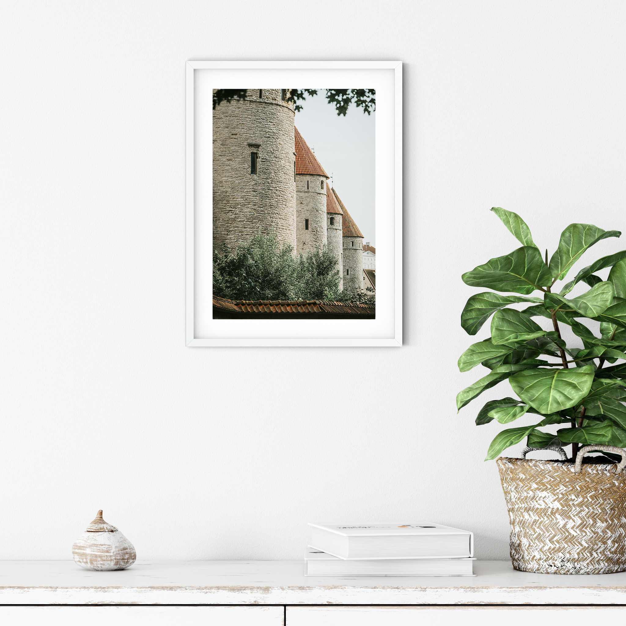 Four Towers - color photography print with border in white frame on the wall