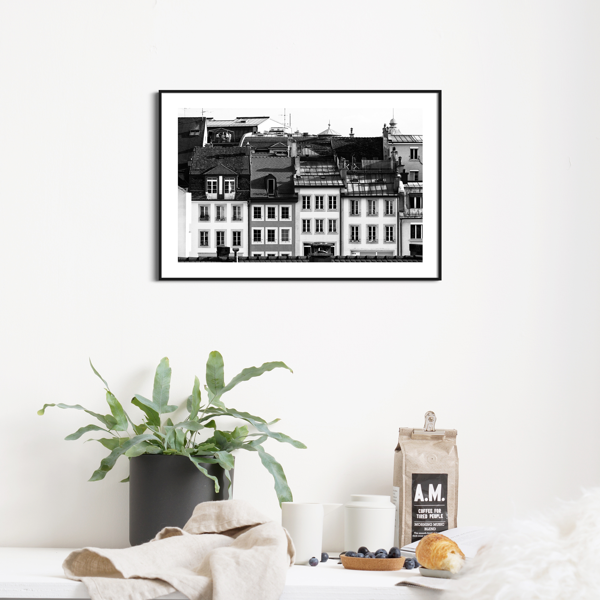 Lausanne Roofs II - black and white print with border in black frame on the wall