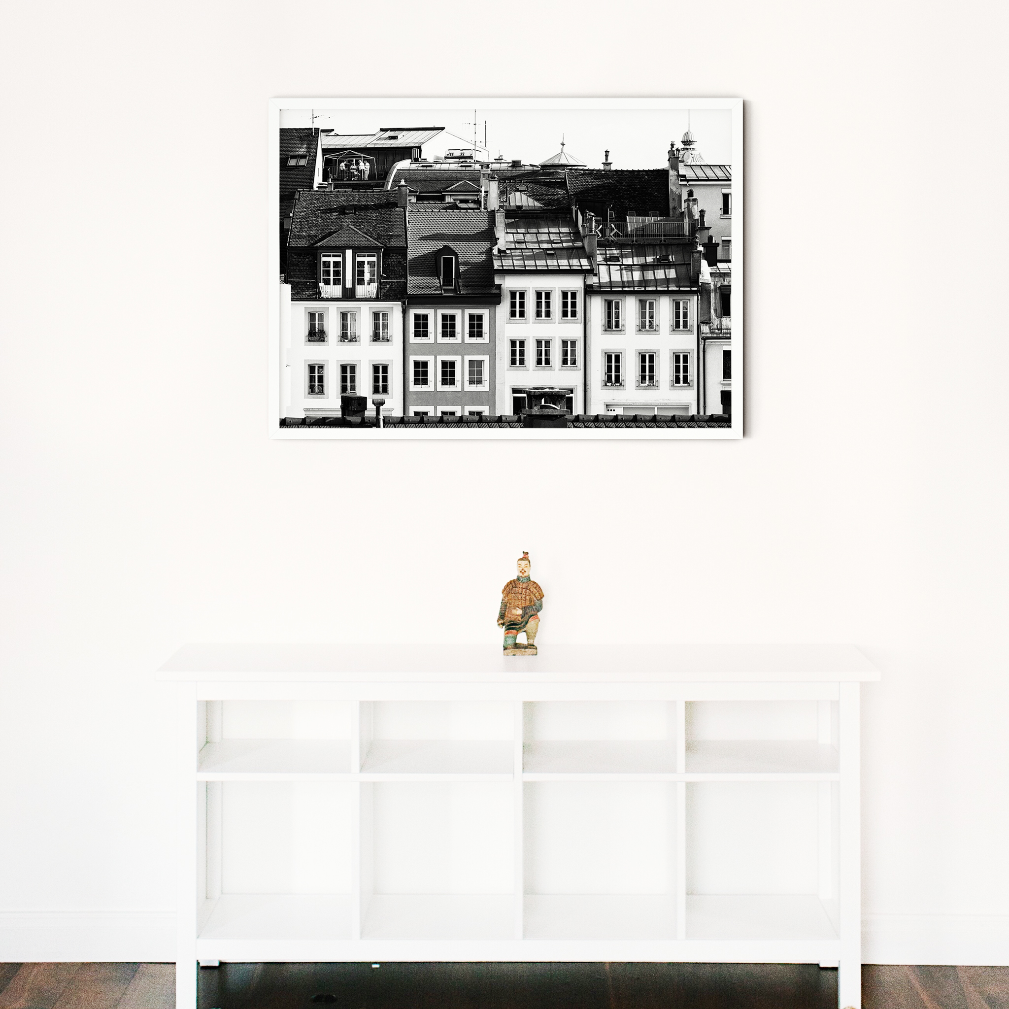 Lausanne Roofs II - black and white print without border in white frame on the wall