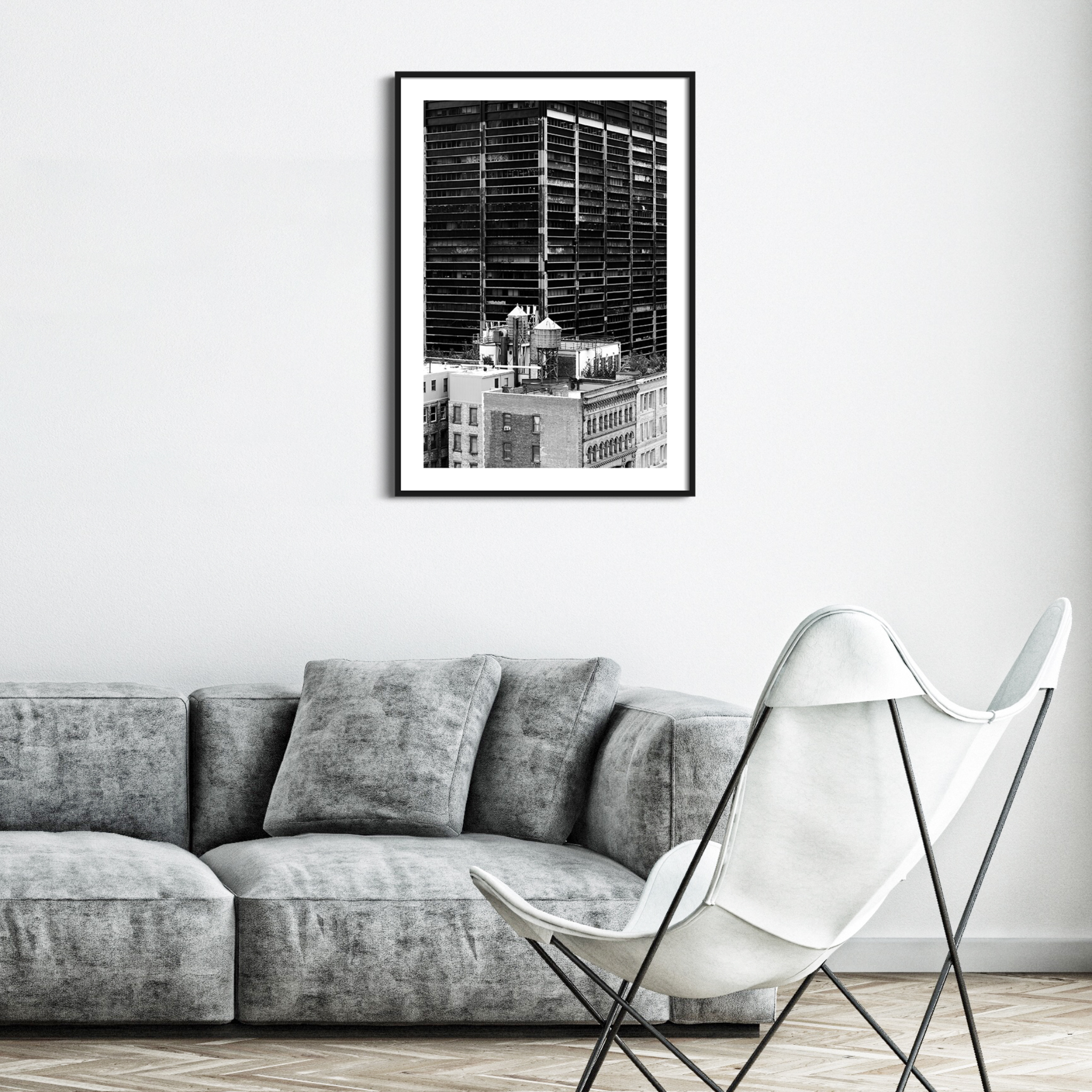 Manhattan Architecture Shot Number 36 - black and white print in white frame on the wall over the sofa