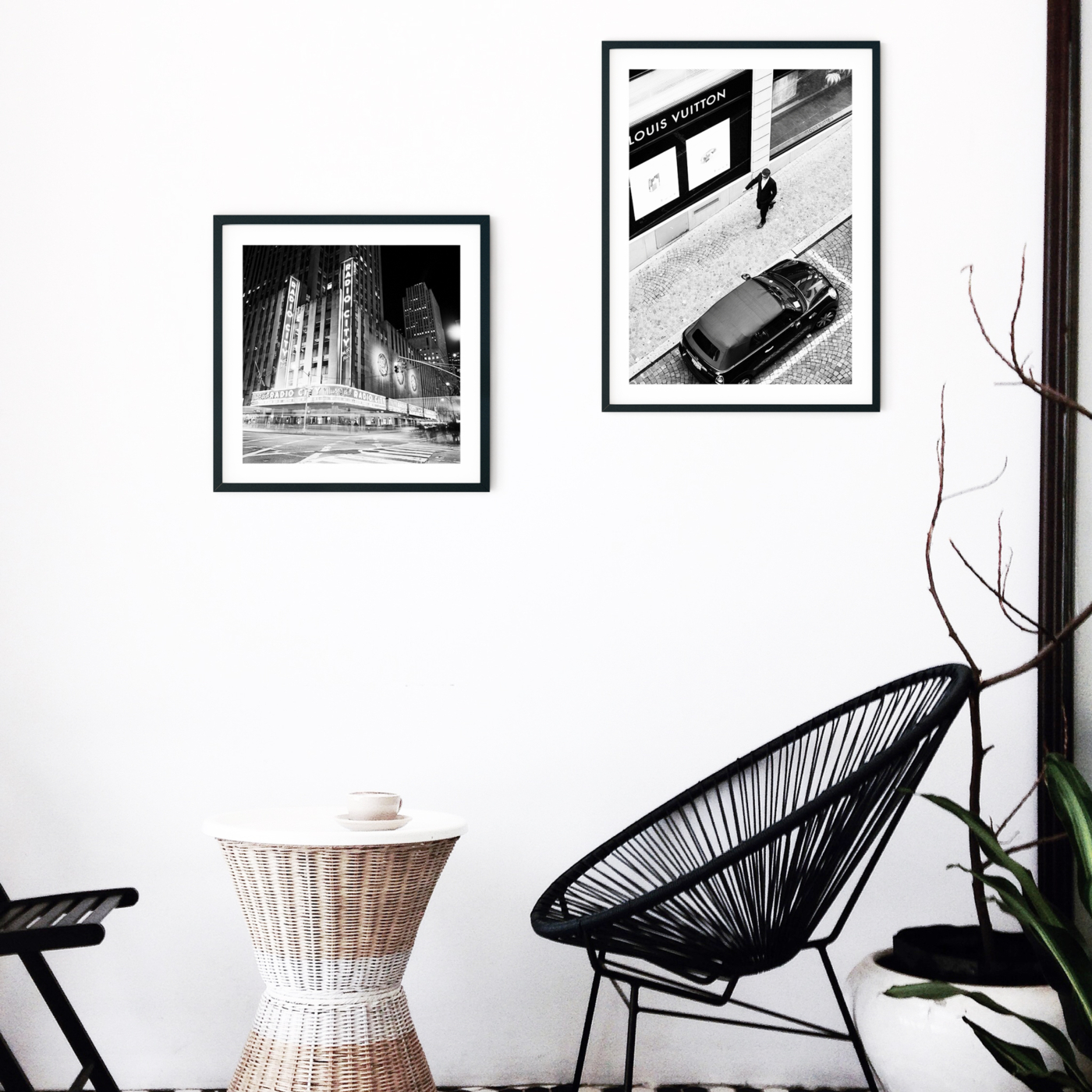 Radio City Music Hall by Night - black and white print with border in black frame on the wall in caffe