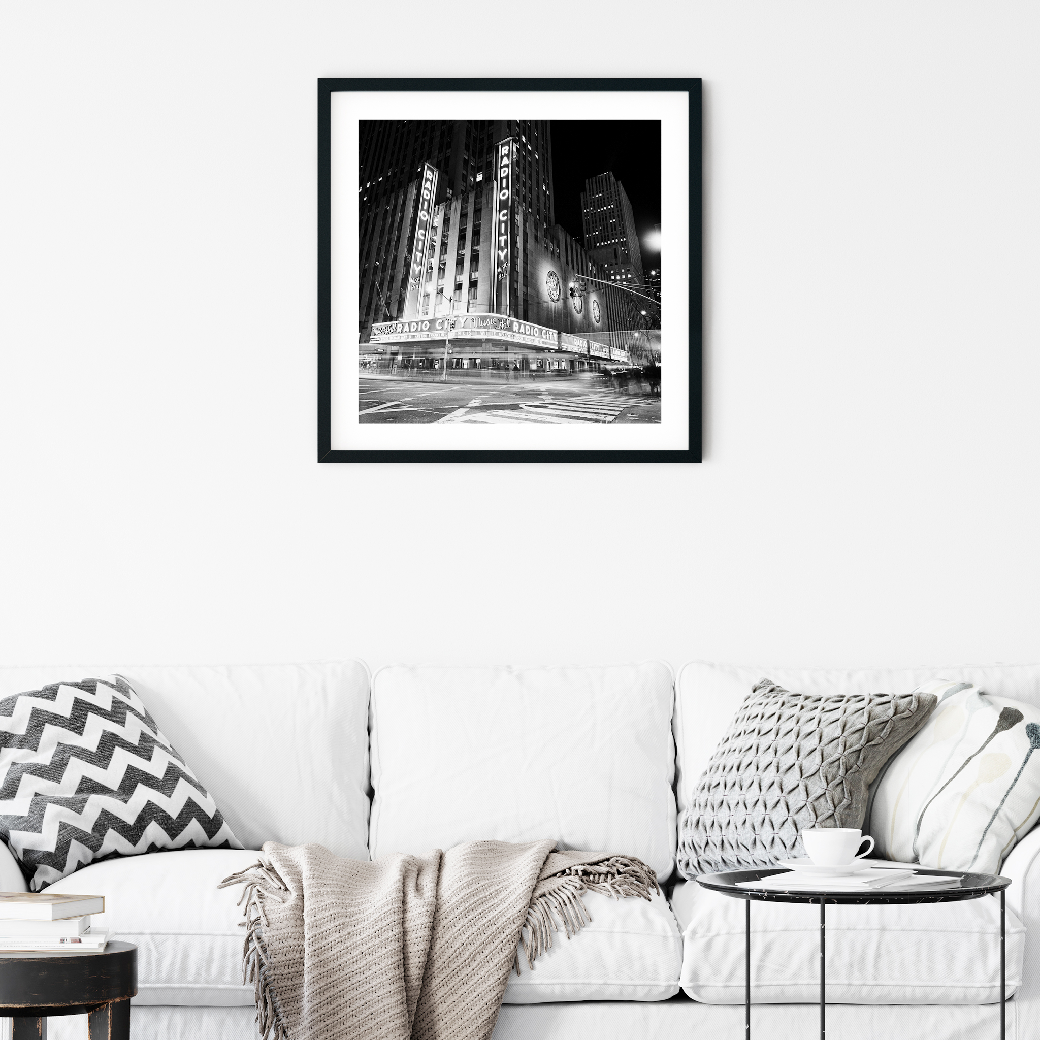 Radio City Music Hall by Night - black and white print with border in black frame on the wall