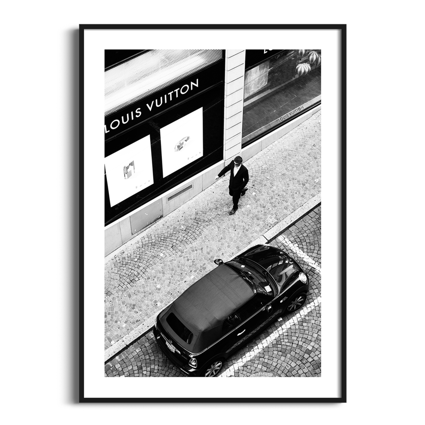 Vuitton Man - black and white print with border in black frame