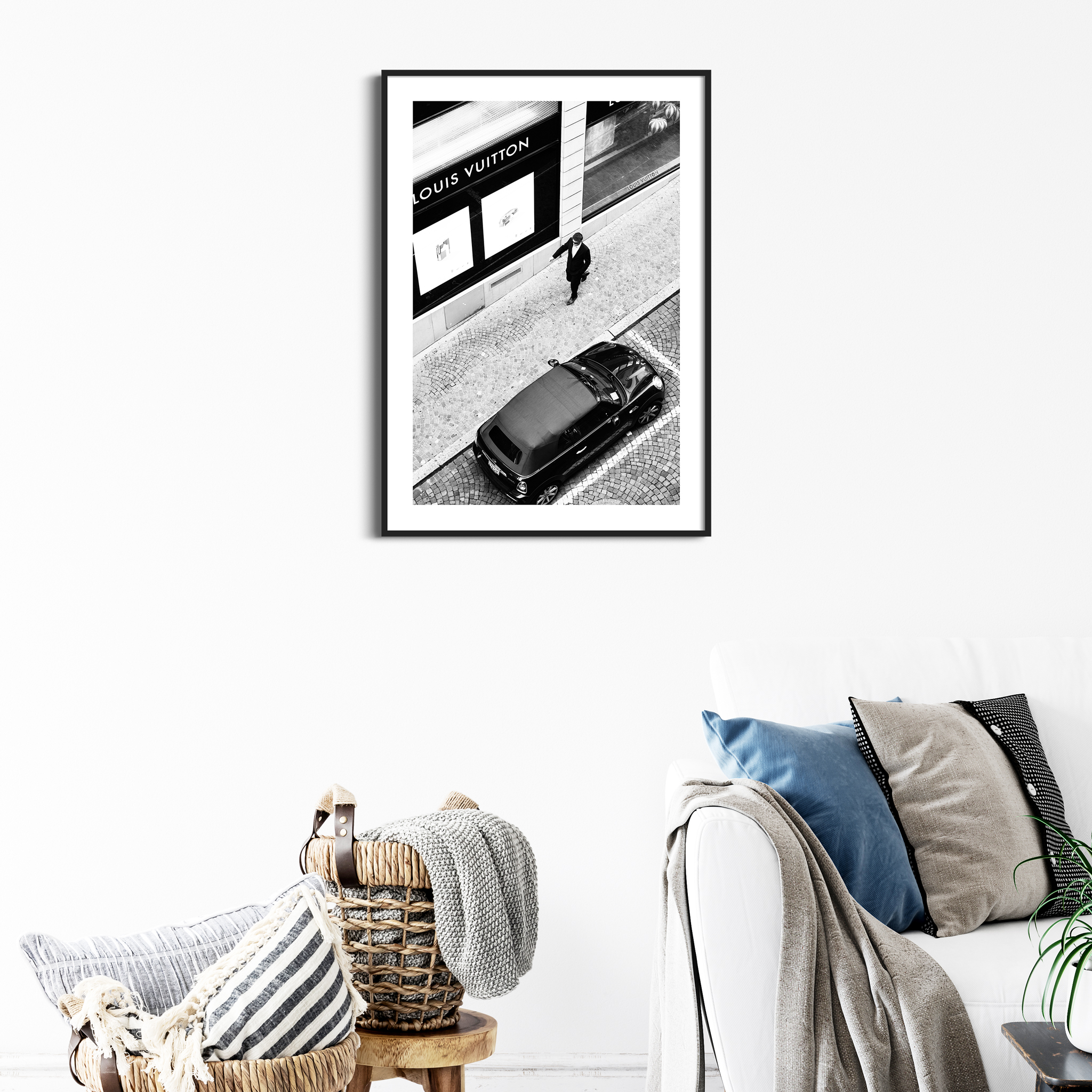 Vuitton Man black and white print with border in black frame on the wall