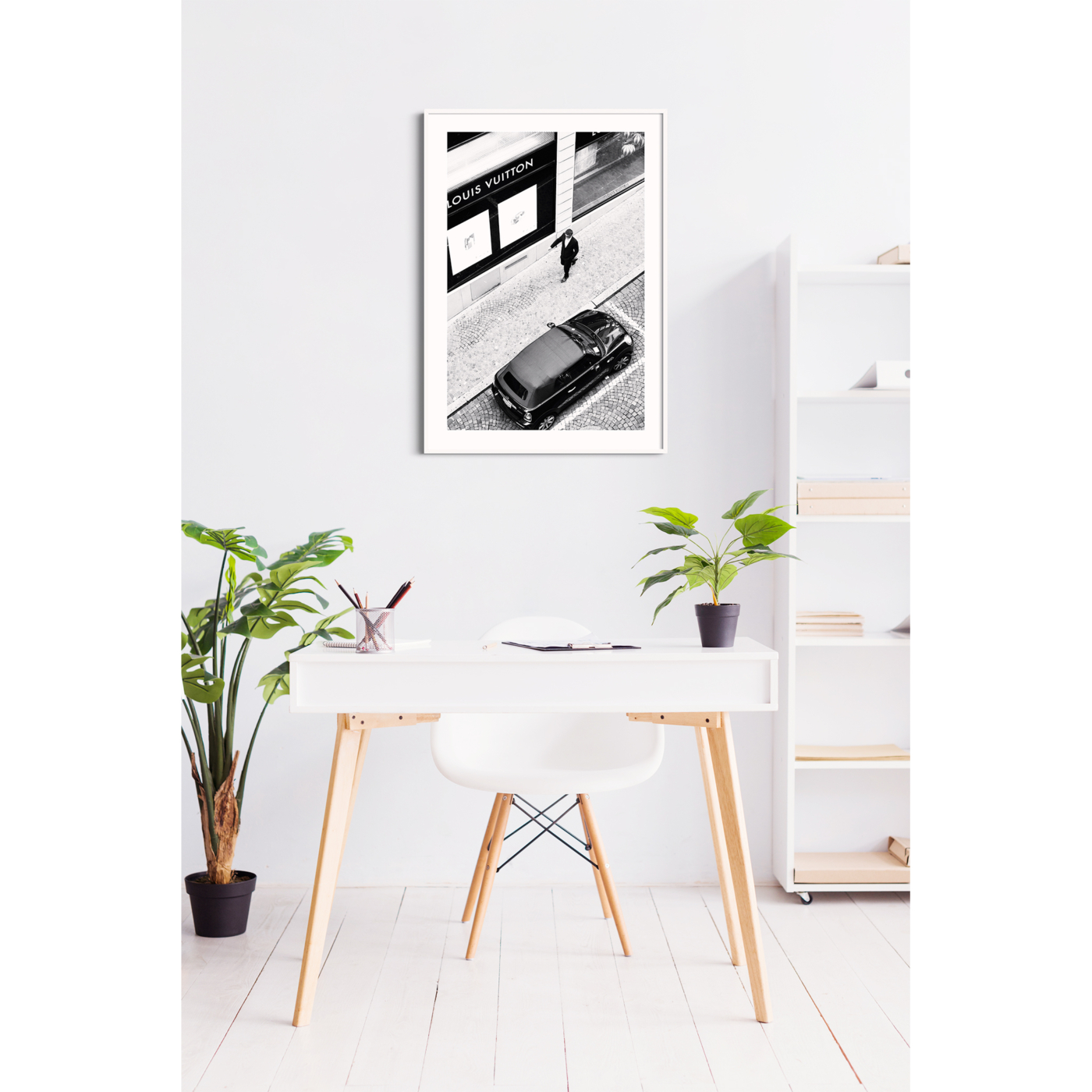 Vuitton Man black and white print with border in white frame on the wall