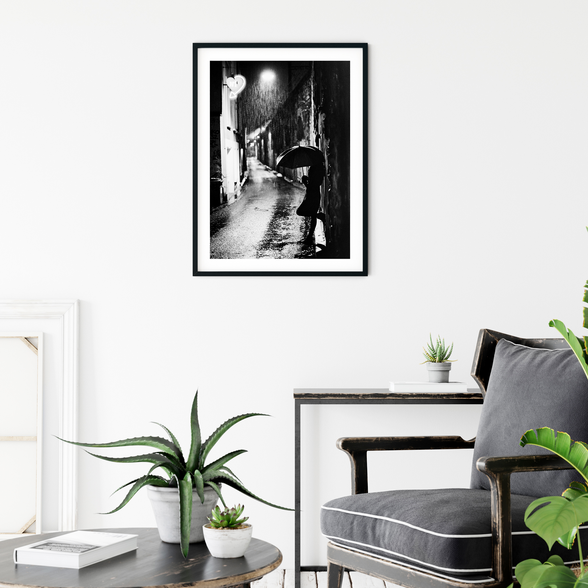 Nightstreet photo - black and white print with border in black frame on the wall in scandi interior