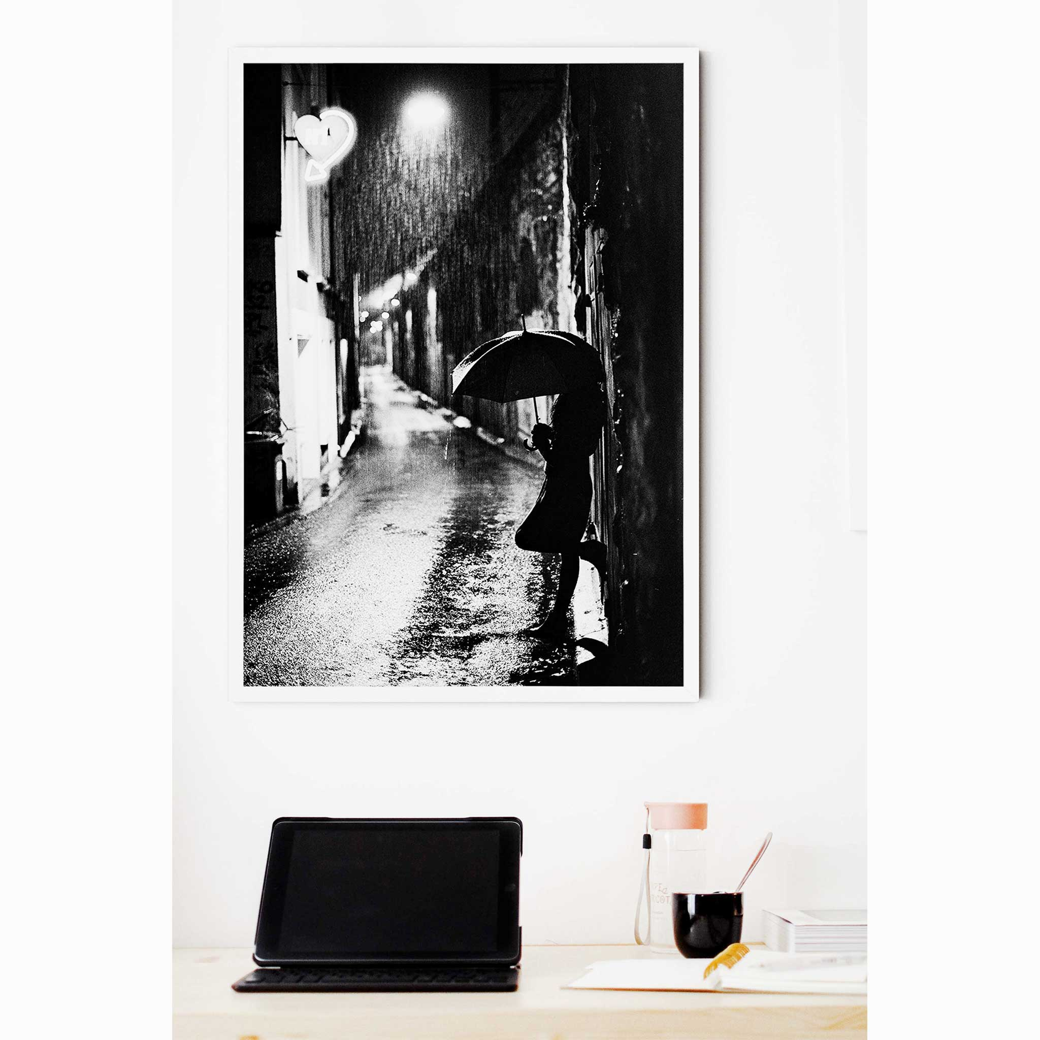 Nightstreet photo - black and white print without border in white frame on the wall