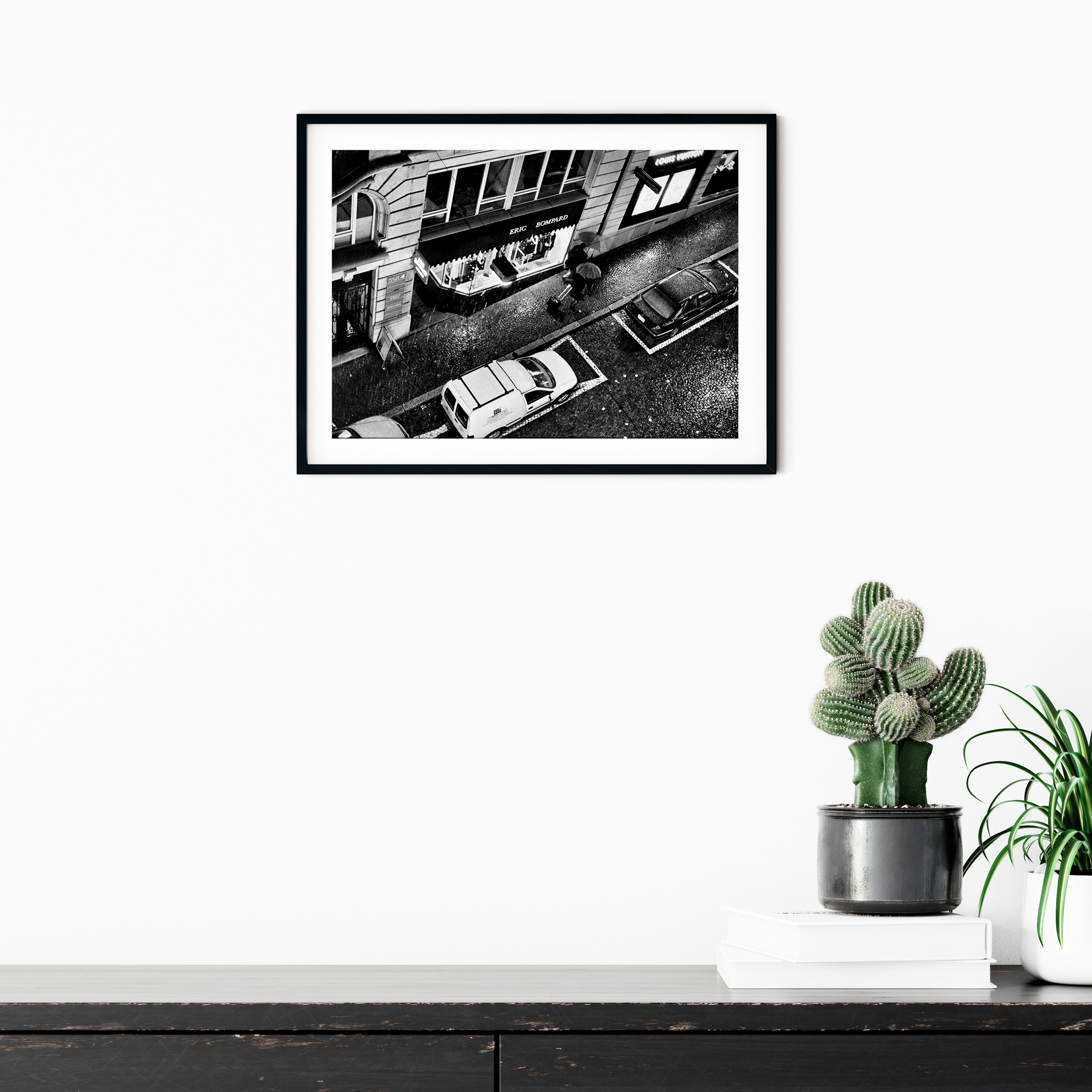 Heavy Rain in Lausanne photography - black and white print with border in black frame on the wall