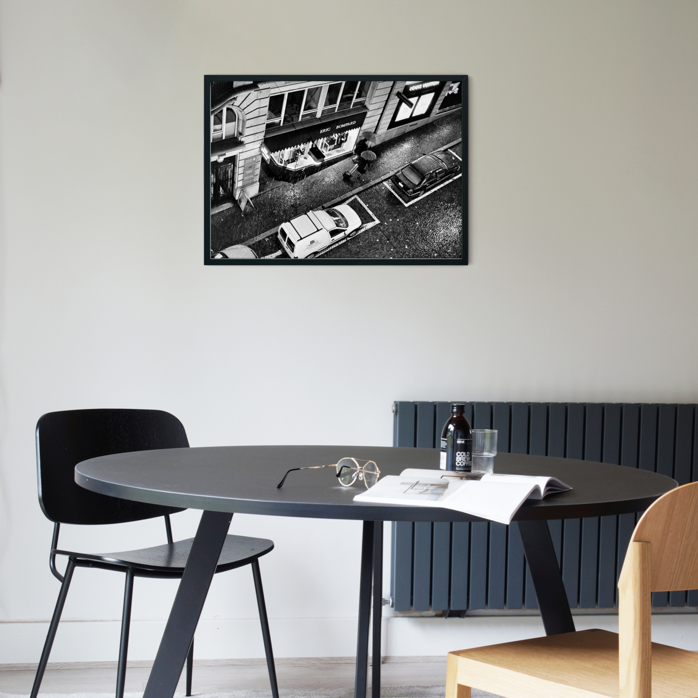 Heavy Rain in Lausanne photography - black and white print without border in black frame on the wall in cafe interior